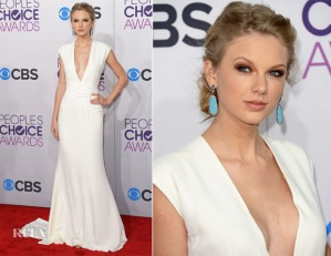 "Taylor Swift shocked all of us this year and looks absolutely stunning in this stark white Ralph Lauren gown, complete with dangling turquoise earrings. The 23 year old newly single songstress sure can rock the camera! She is definitely my pick for 'Best Dressed' at this year's ""People's Choice Awards."""